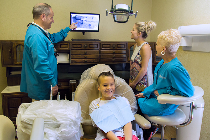 Doctor explaining x-rays at Jon C. Packman DDS Office