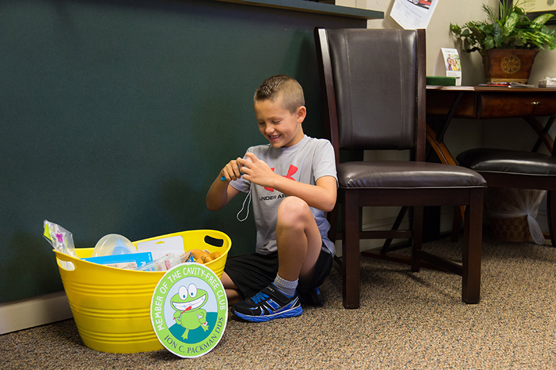 Boy playing in patient waiting area at Jon C. Packman DDS Office