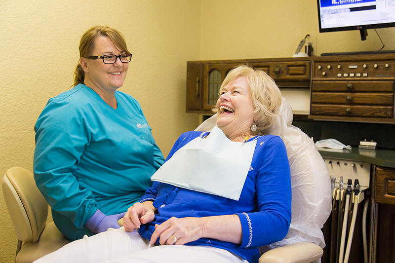 Patient and dental assistant laughing at Jon C. Packman DDS Office