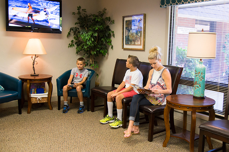 Family waiting for dental visit at Jon C. Packman DDS Office