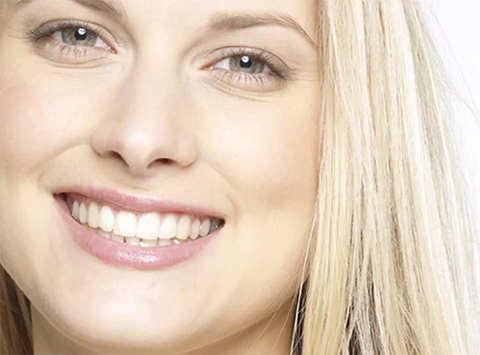 Blond woman with white teeth at Jon C. Packman DDS
