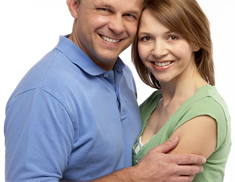 Smiling couple after receiving dental sealants at Jon C. Packman DDS
