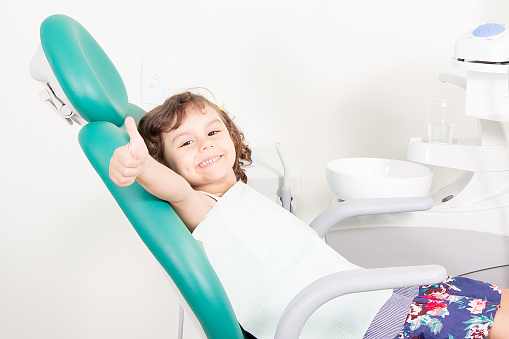 A smiling child at Jon C. Packman DDS in Statesville, NC